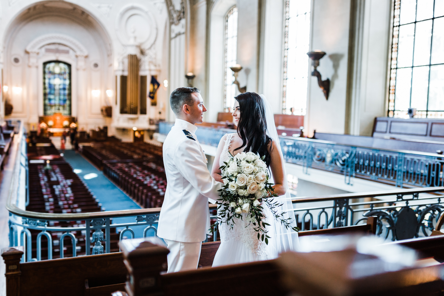 bride and groom together inside naval academy chapel