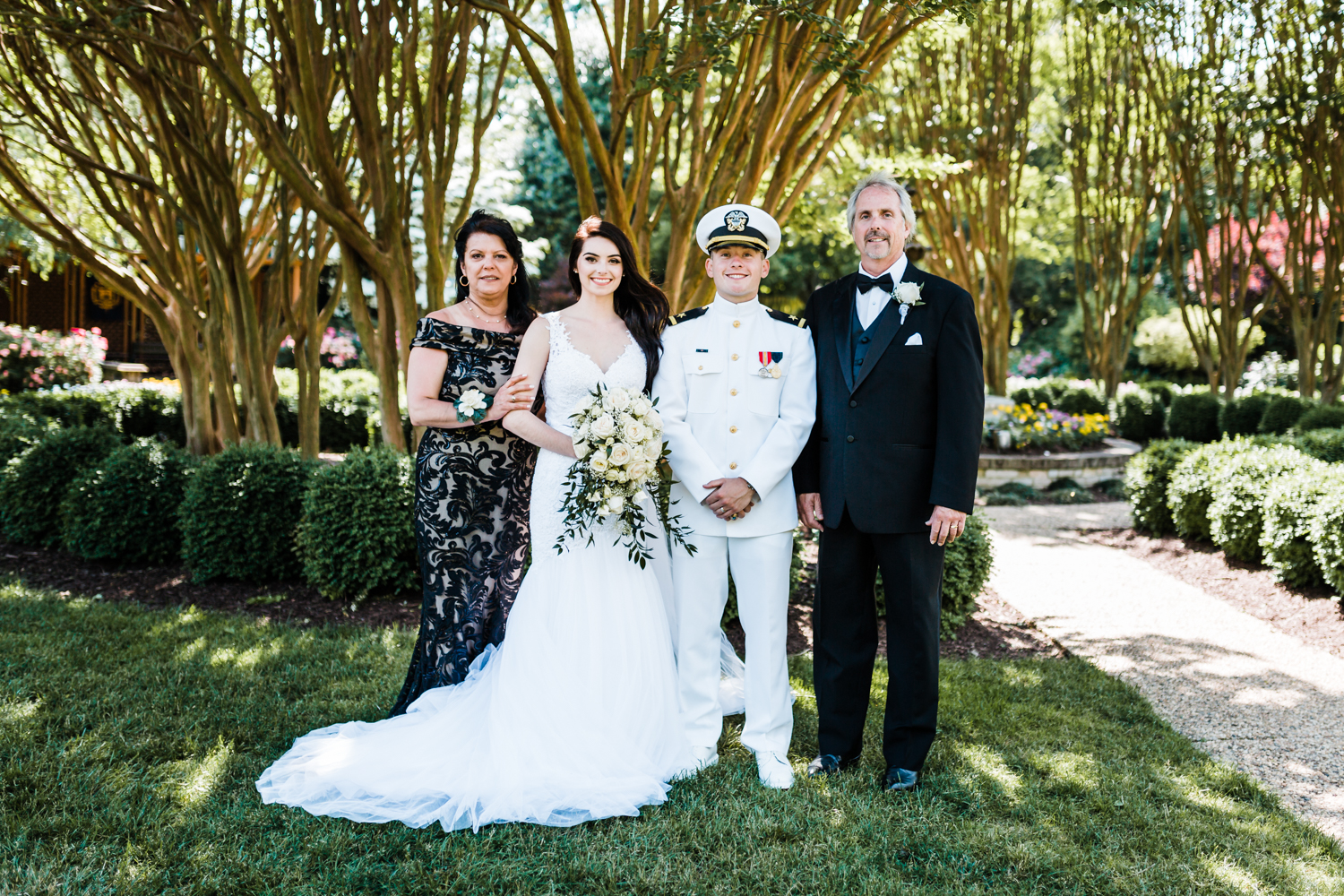 bride and groom with bride's parents