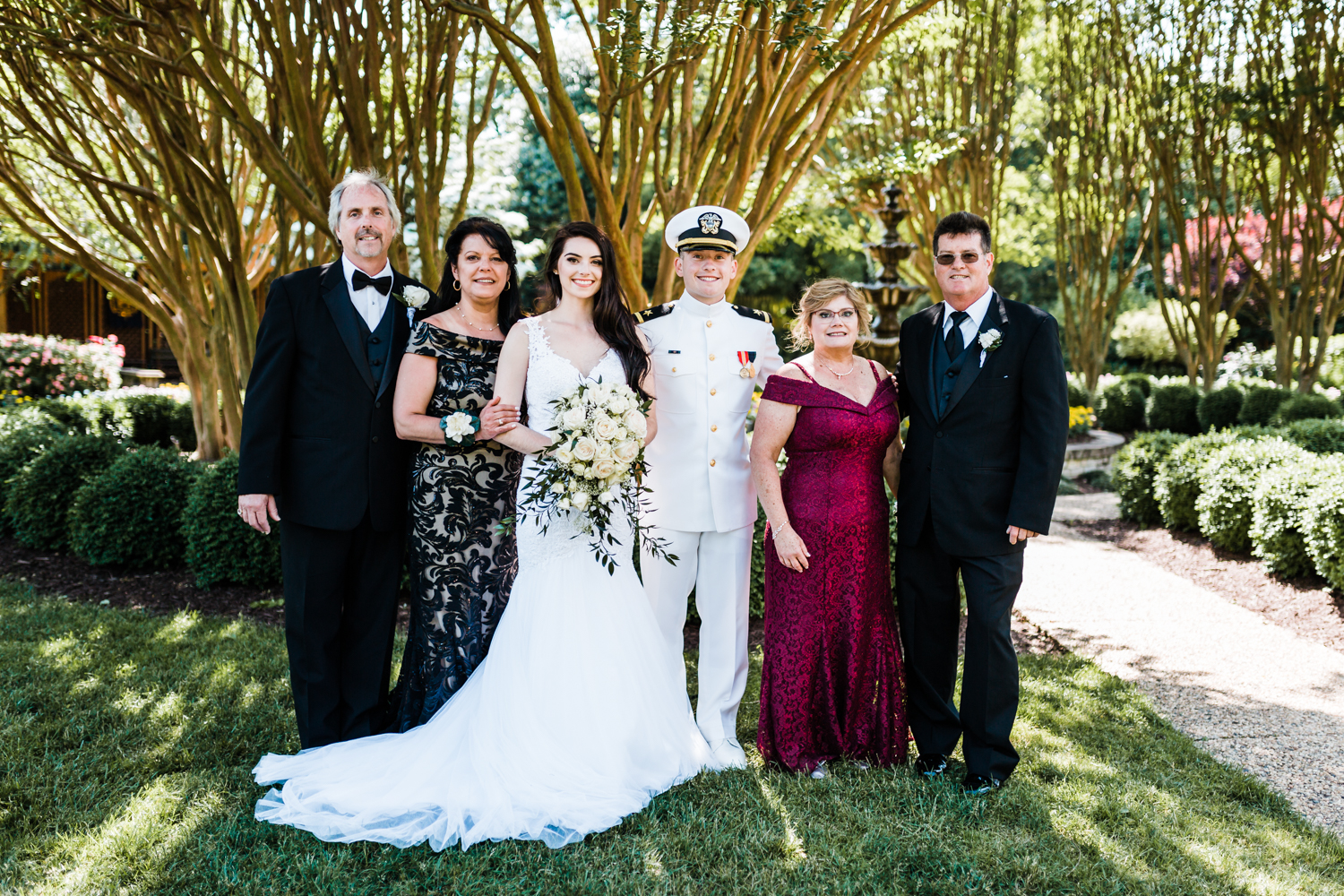 bride and groom with both of their parents