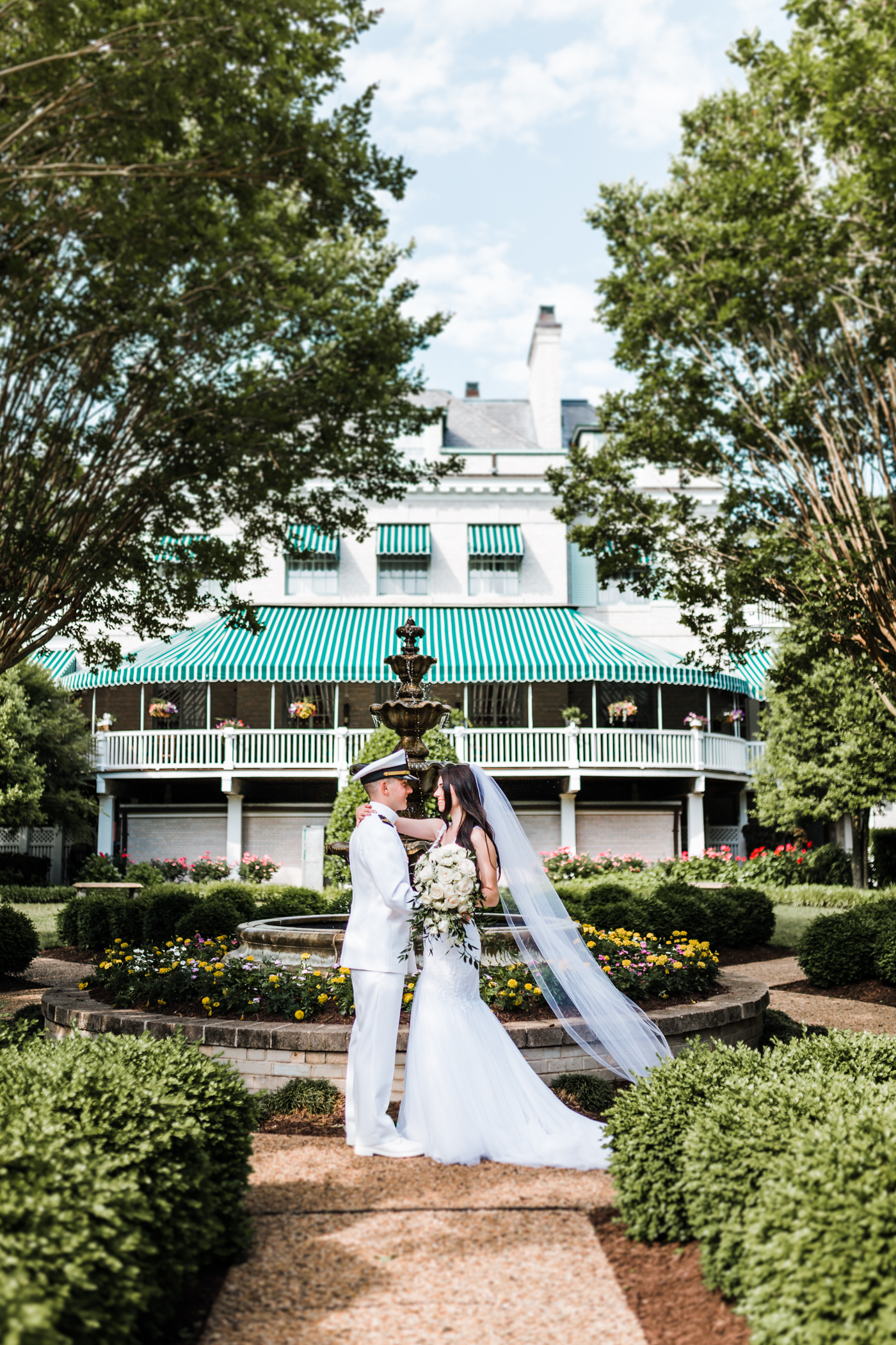 bride and groom in superintendent's garden at naval academy in annapolis, md