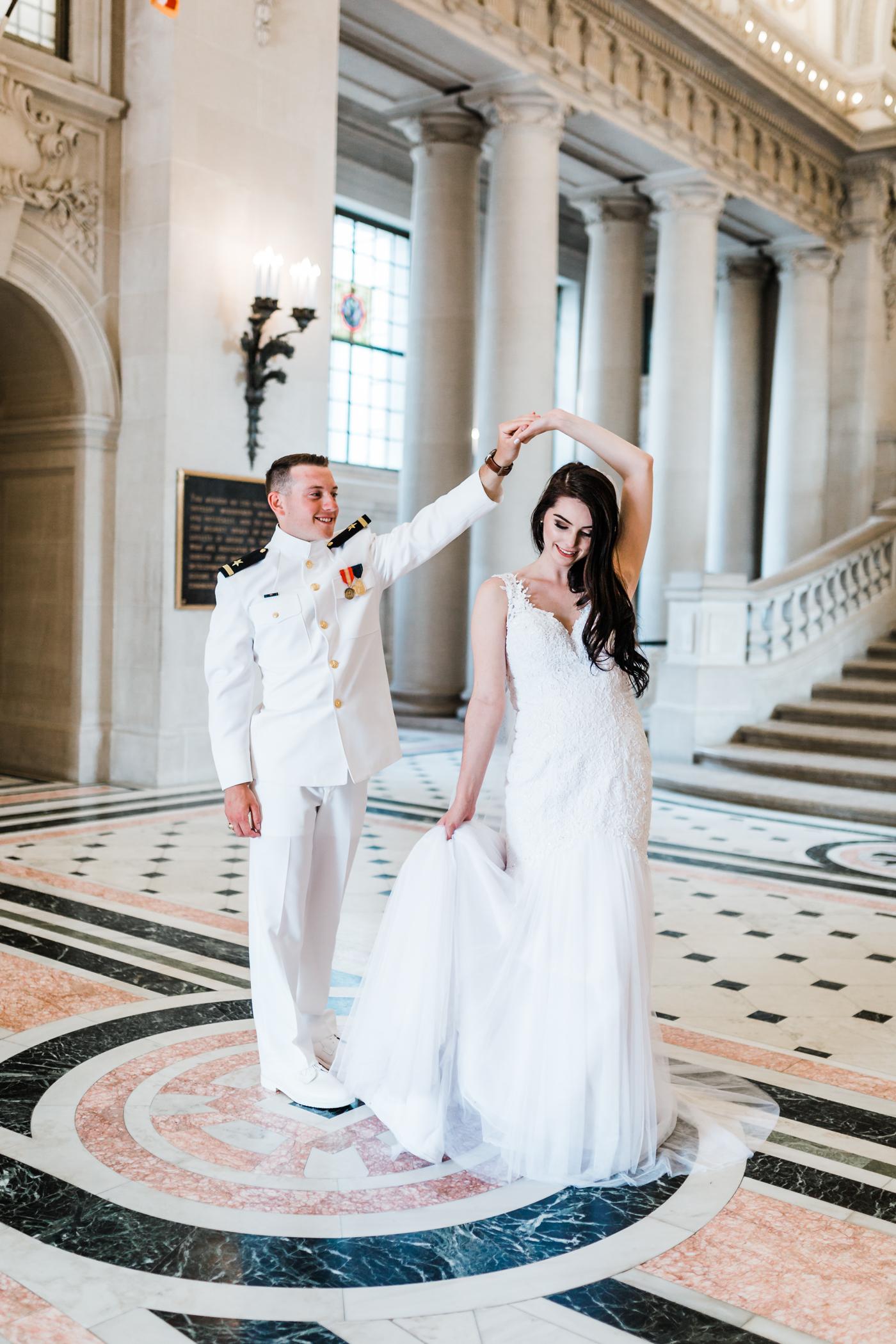 bride groom dancing at naval academy