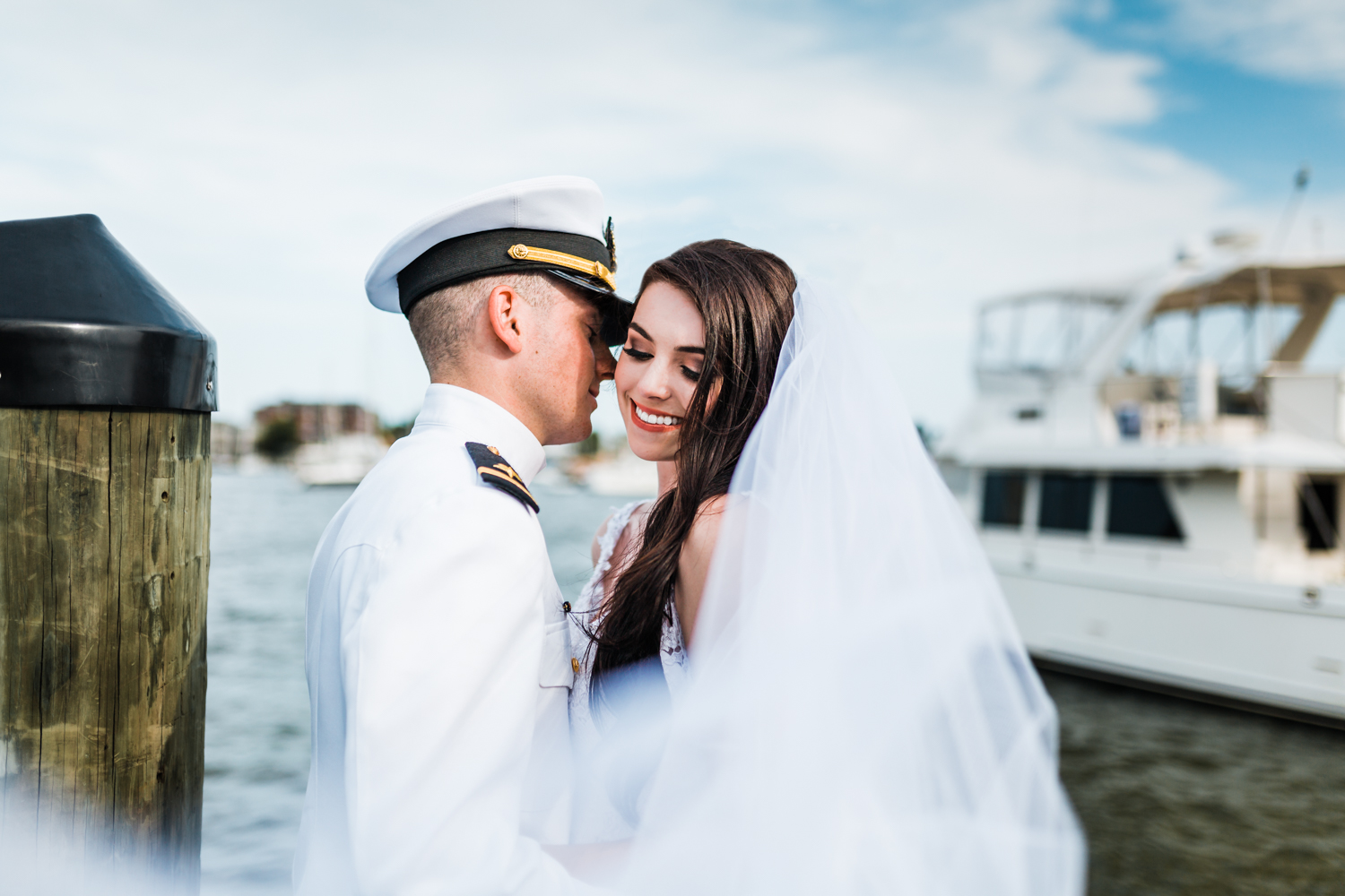 bride and groom on the docks in annapolis, md
