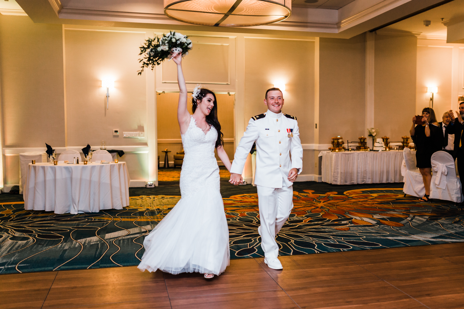 bride and groom enter their reception at the annapolis waterfront hotel