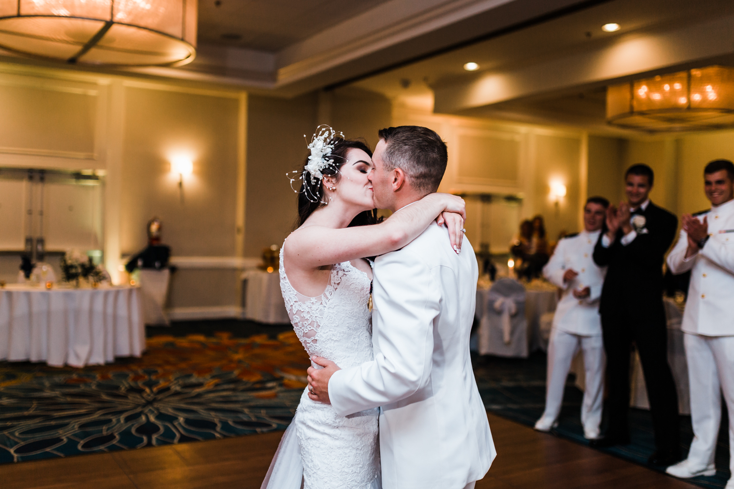 bride and groom kiss during their first dance in annapolis, md