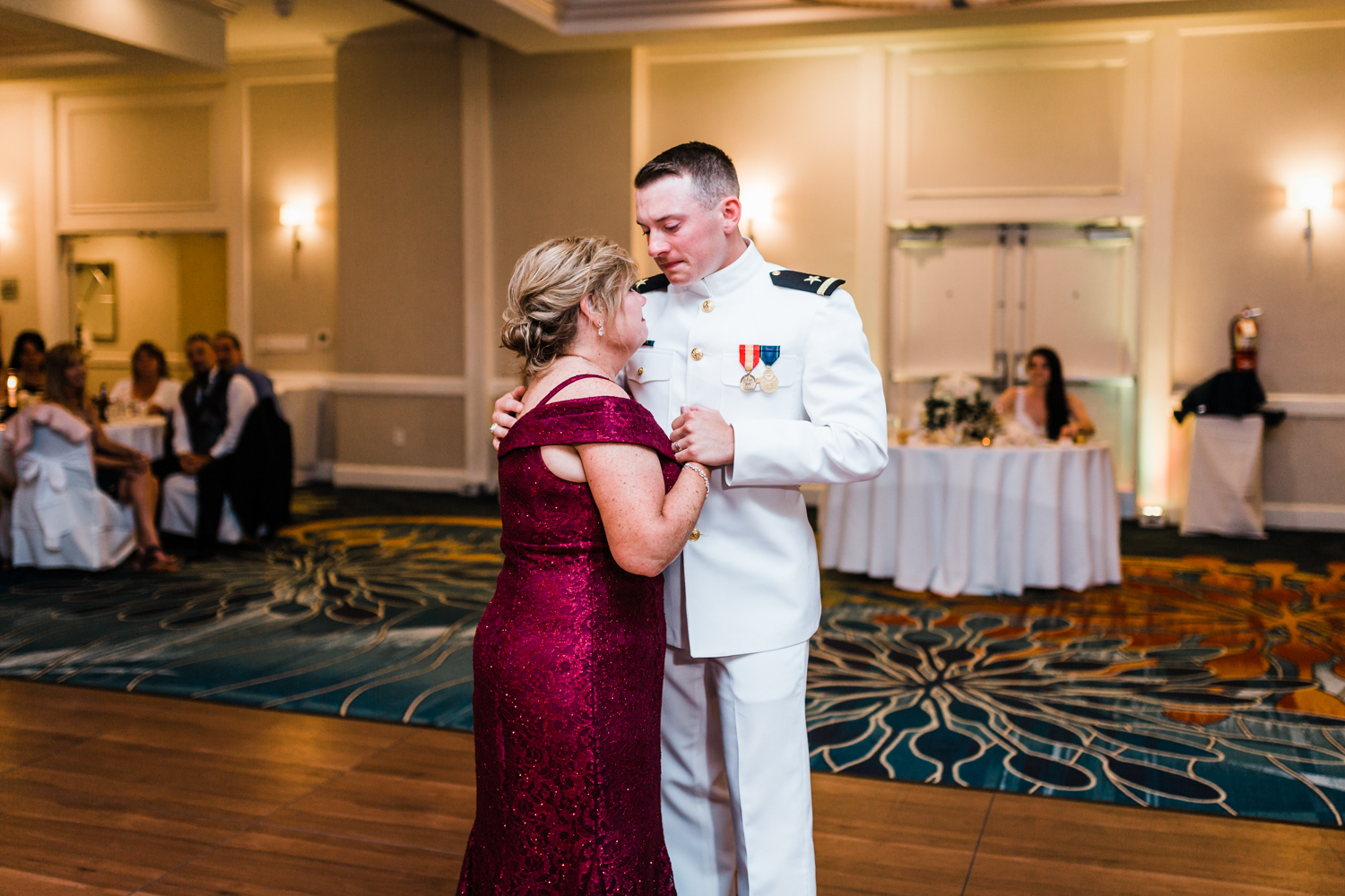 groom shares an emotional dance with his mom at his annapolis wedding