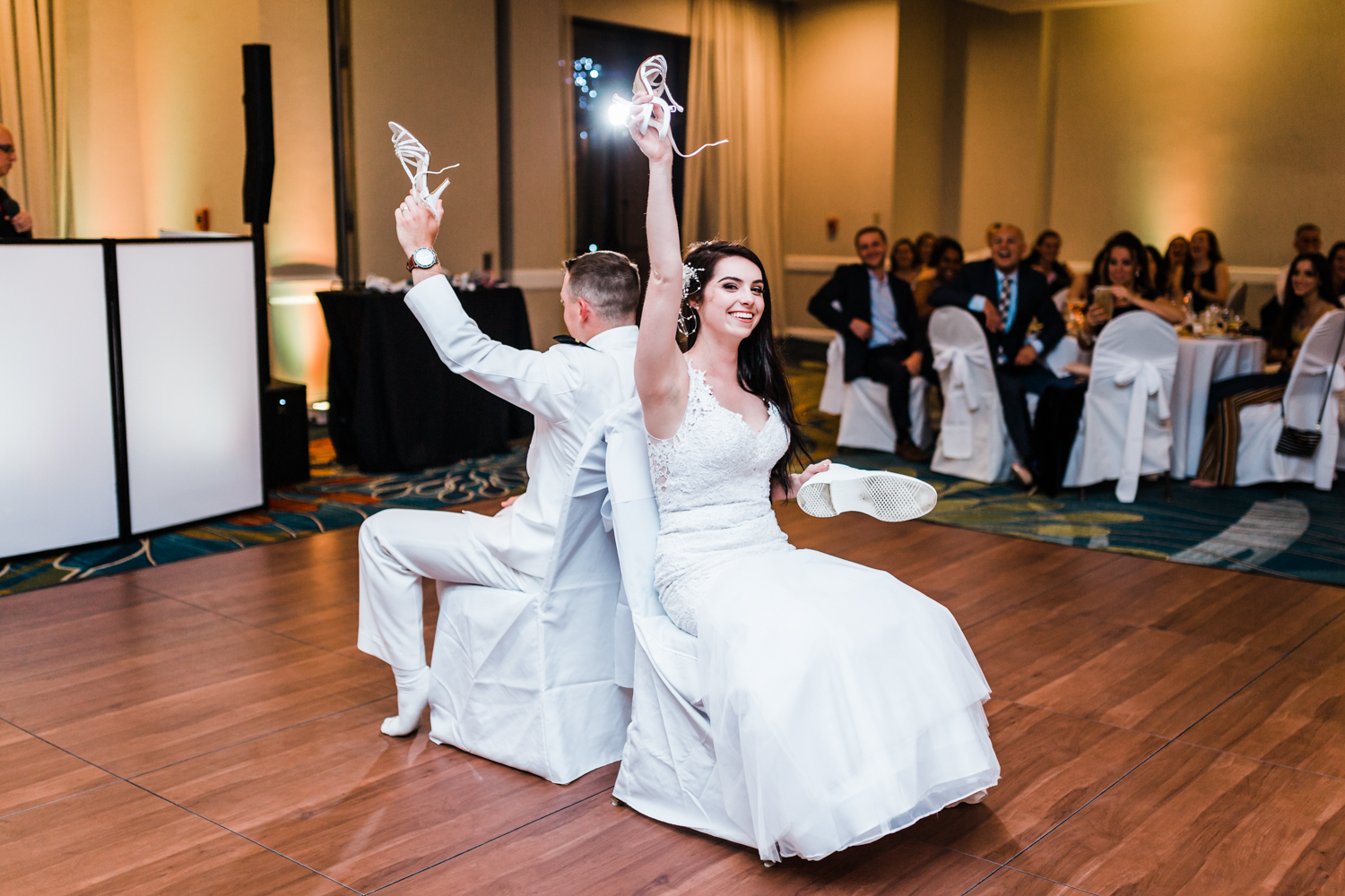 bride and groom play the shoe game at annapolis waterfront hotel reception