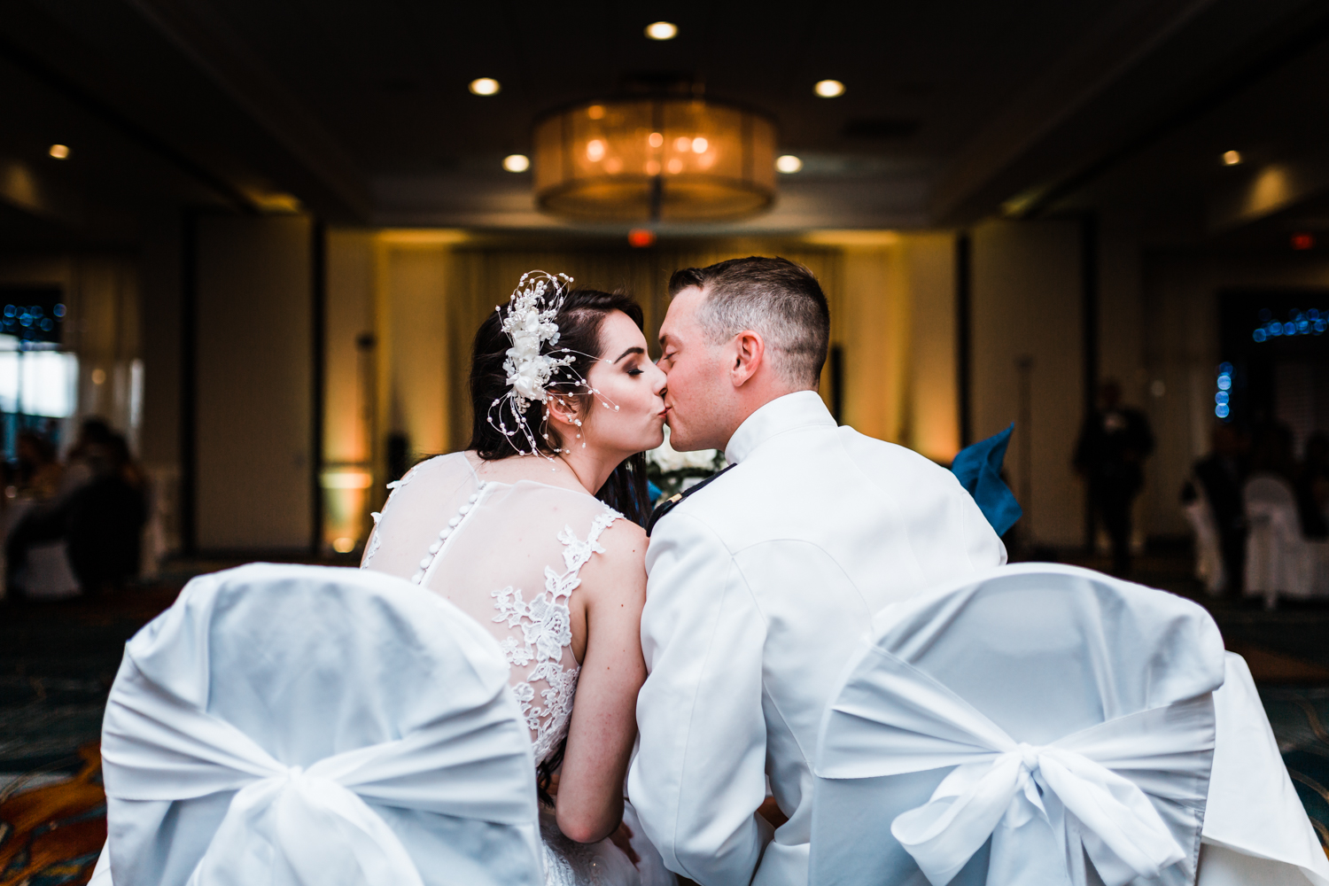 bride and groom kiss at their reception - annapolis waterfront hotel wedding photographers