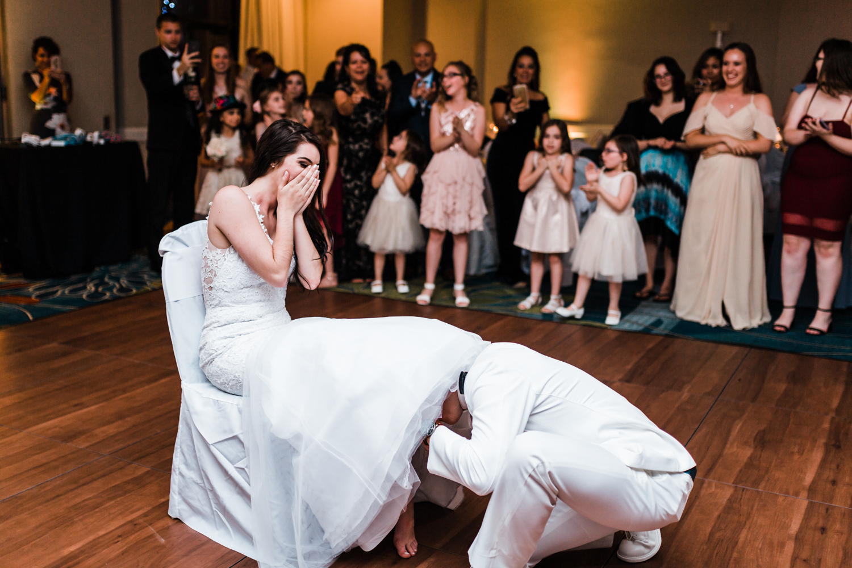 groom-gets-garter.jpg