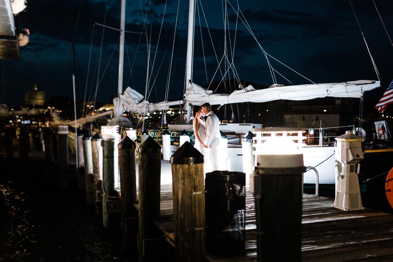 bride and groom on the docks - annapolis maryland wedding photographer - night photography