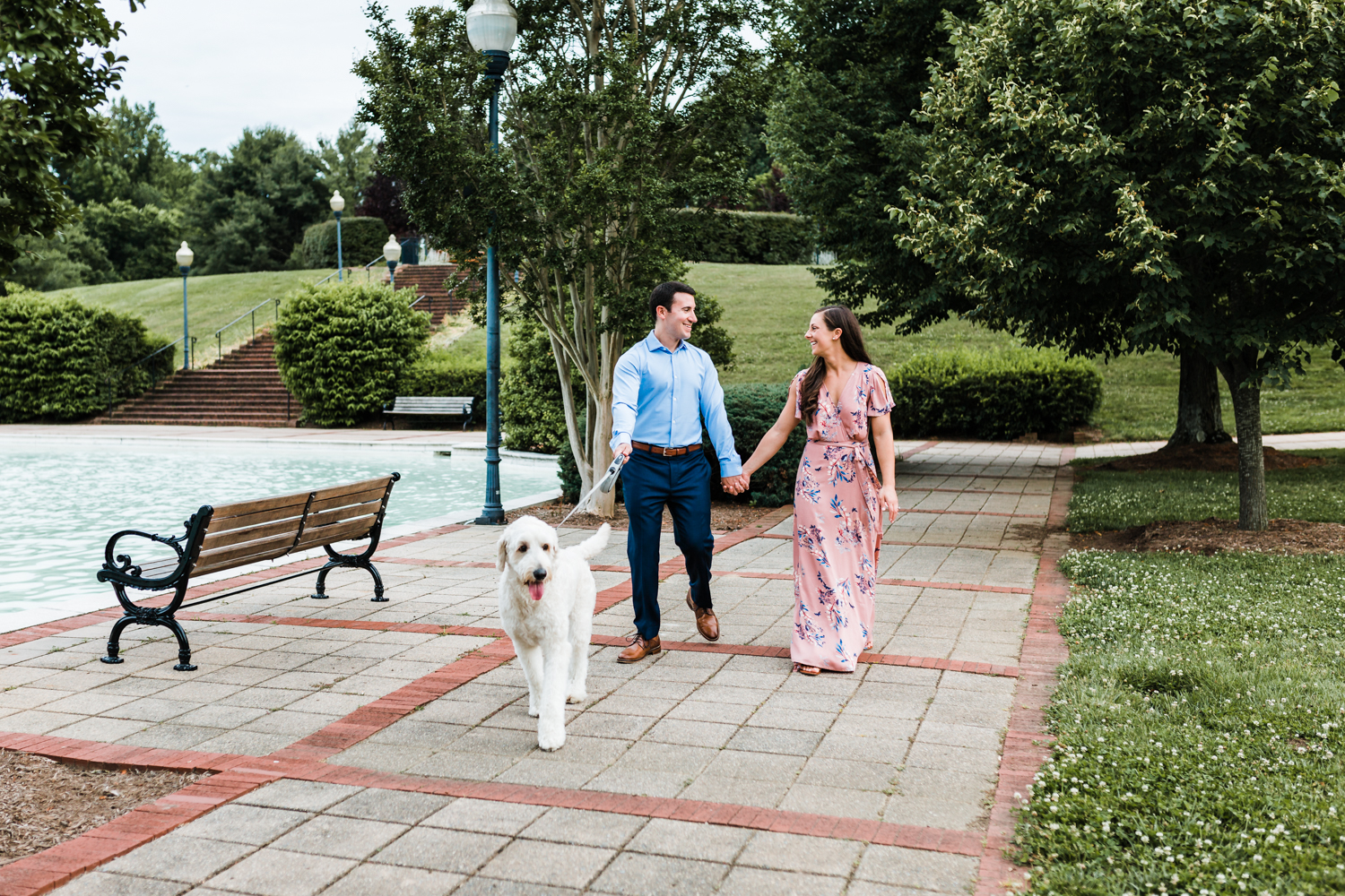 Bride and Groom with their goldendoodle, Teddy, at their engagement session - top rated wedding photographer in Maryland near Annapolis