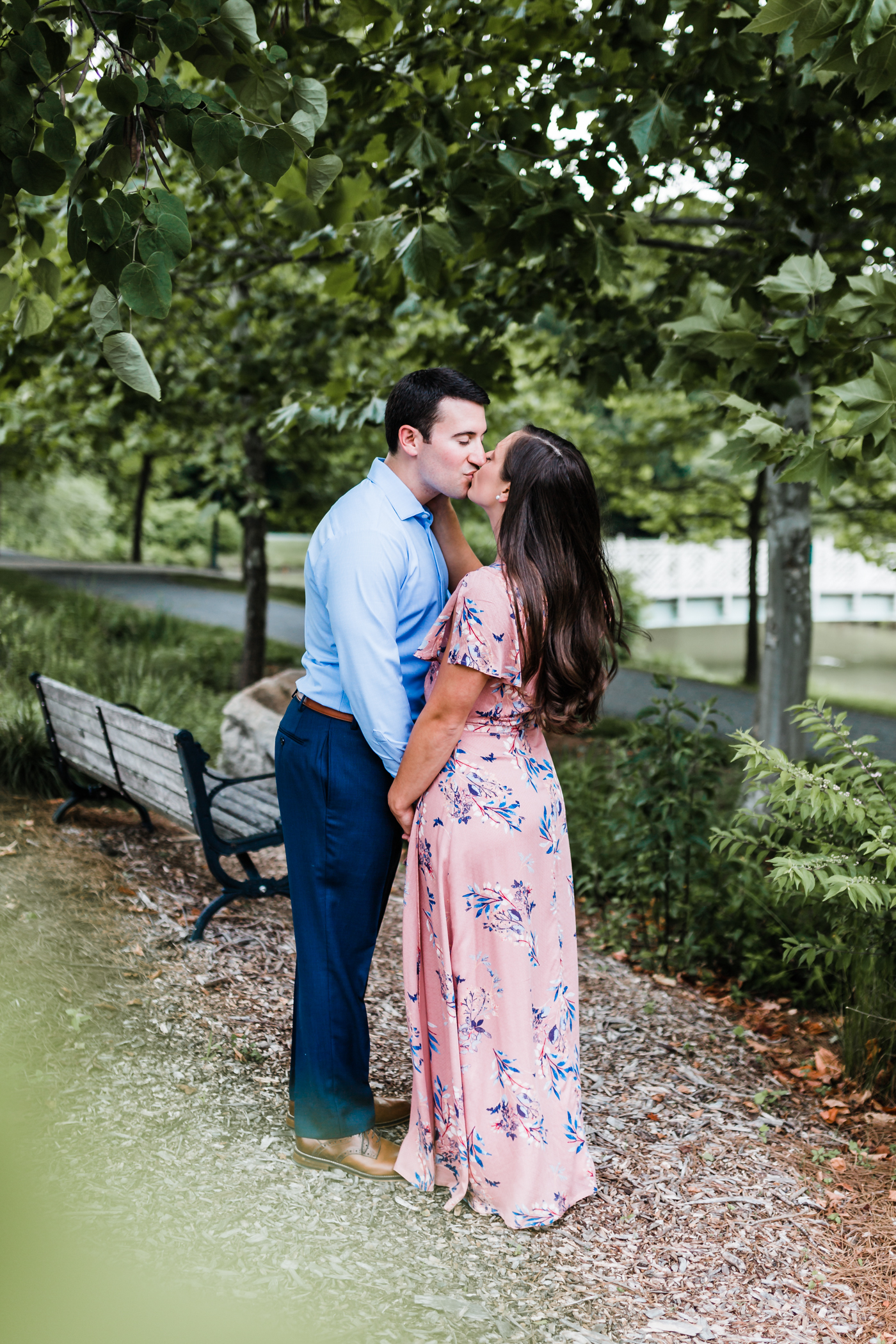 couple kisses at Quiet Waters Park - best photography locations in Maryland for engagement photos