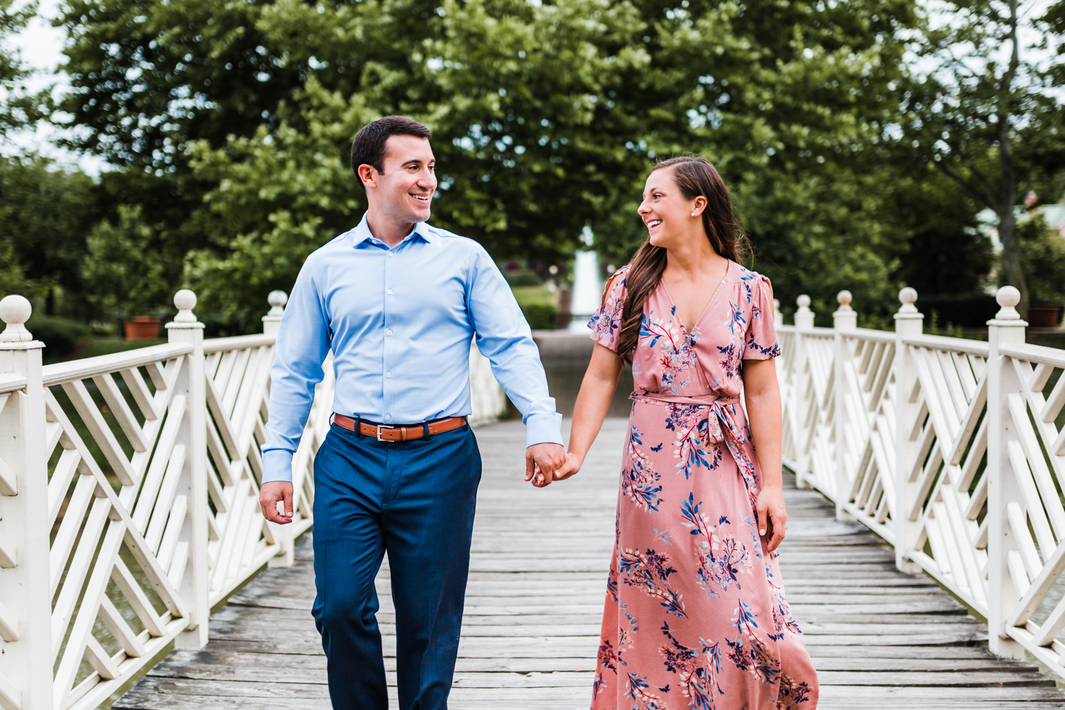 couple walking and laughing together on the bridge at Quiet Waters Park - Annapolis, MD