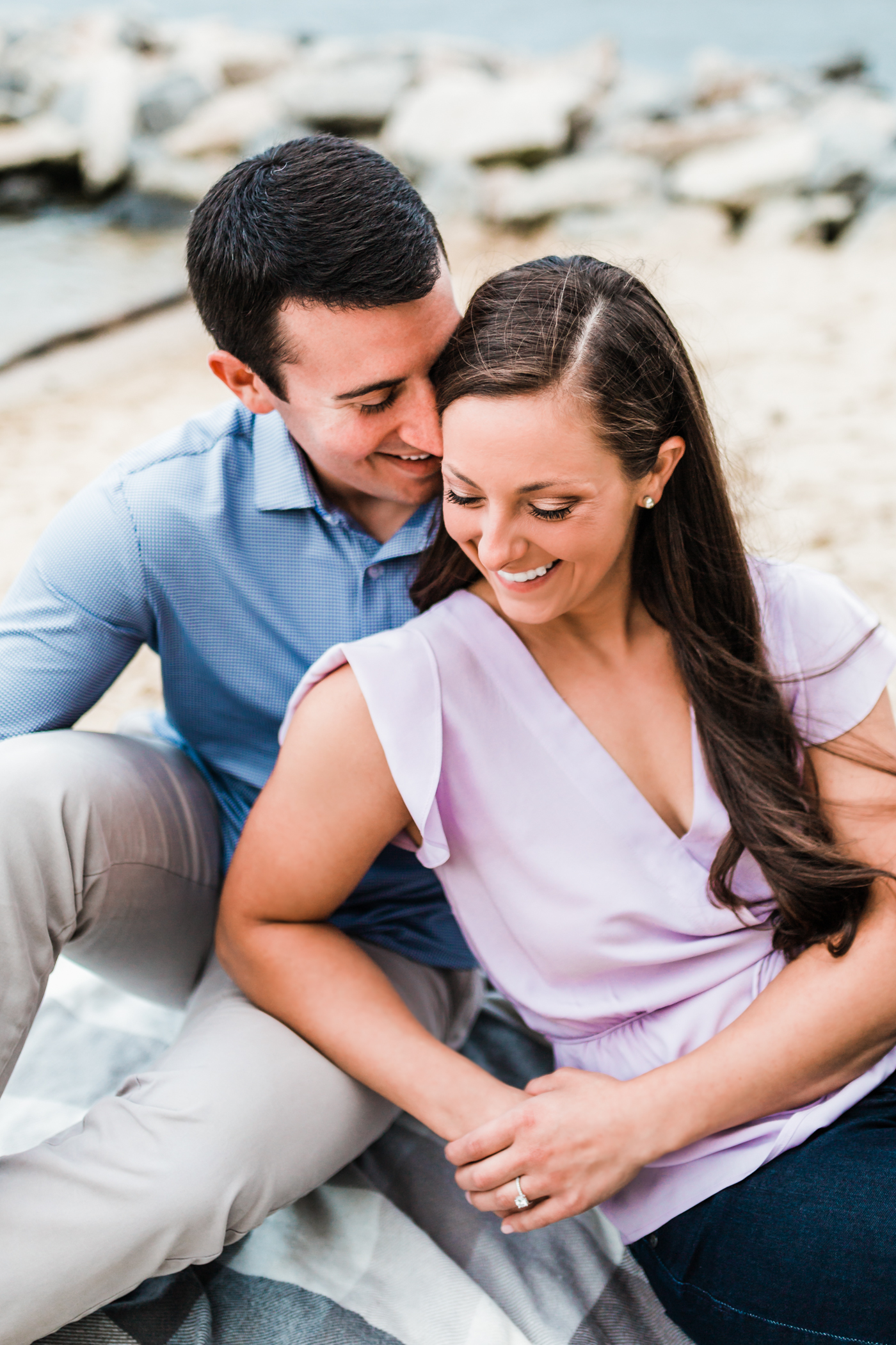 couple snuggling together - best husband and wife photography and cinematography team in Maryland