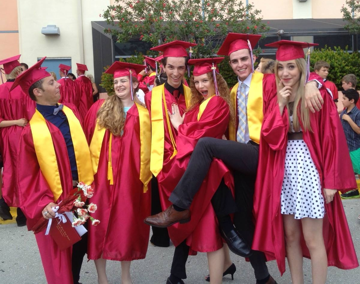 Ben with friends at his high school graduation ceremony.