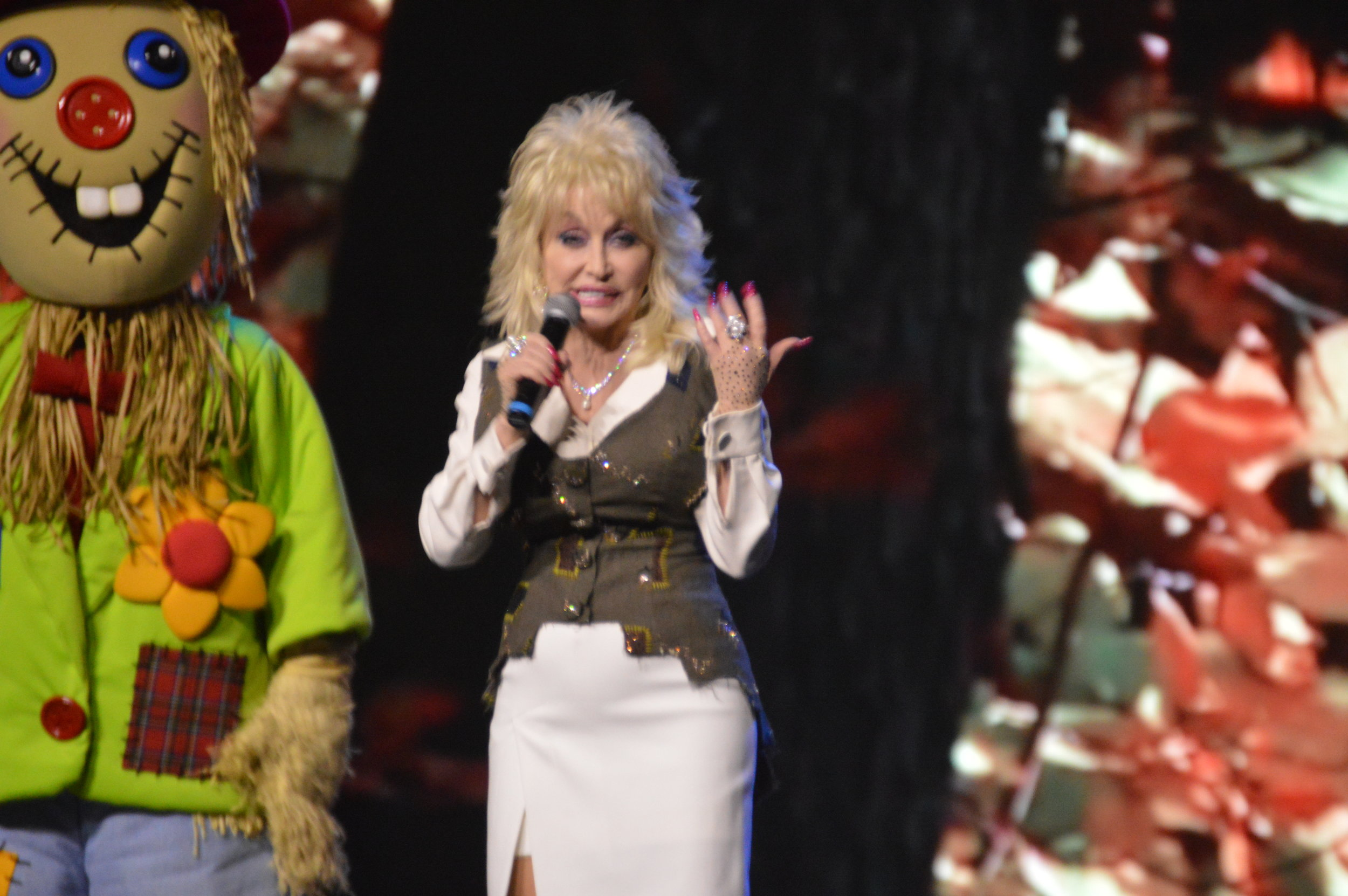 Dolly Parton tells a crowd gathered at Dollywood what to expect at this year's Harvest Festival.