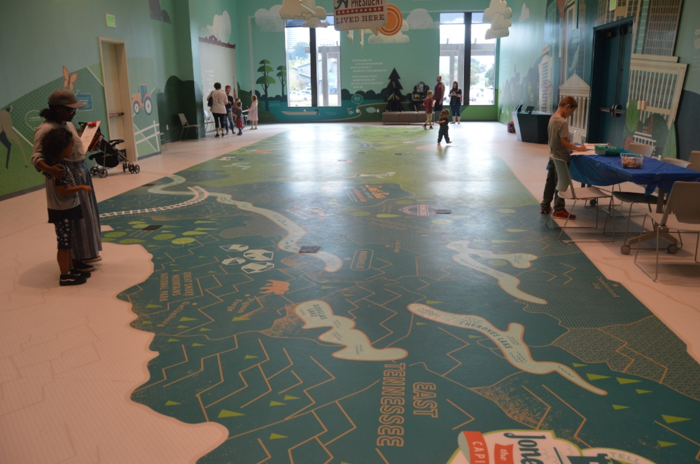 The Children's Gallery features a large map of the state.
