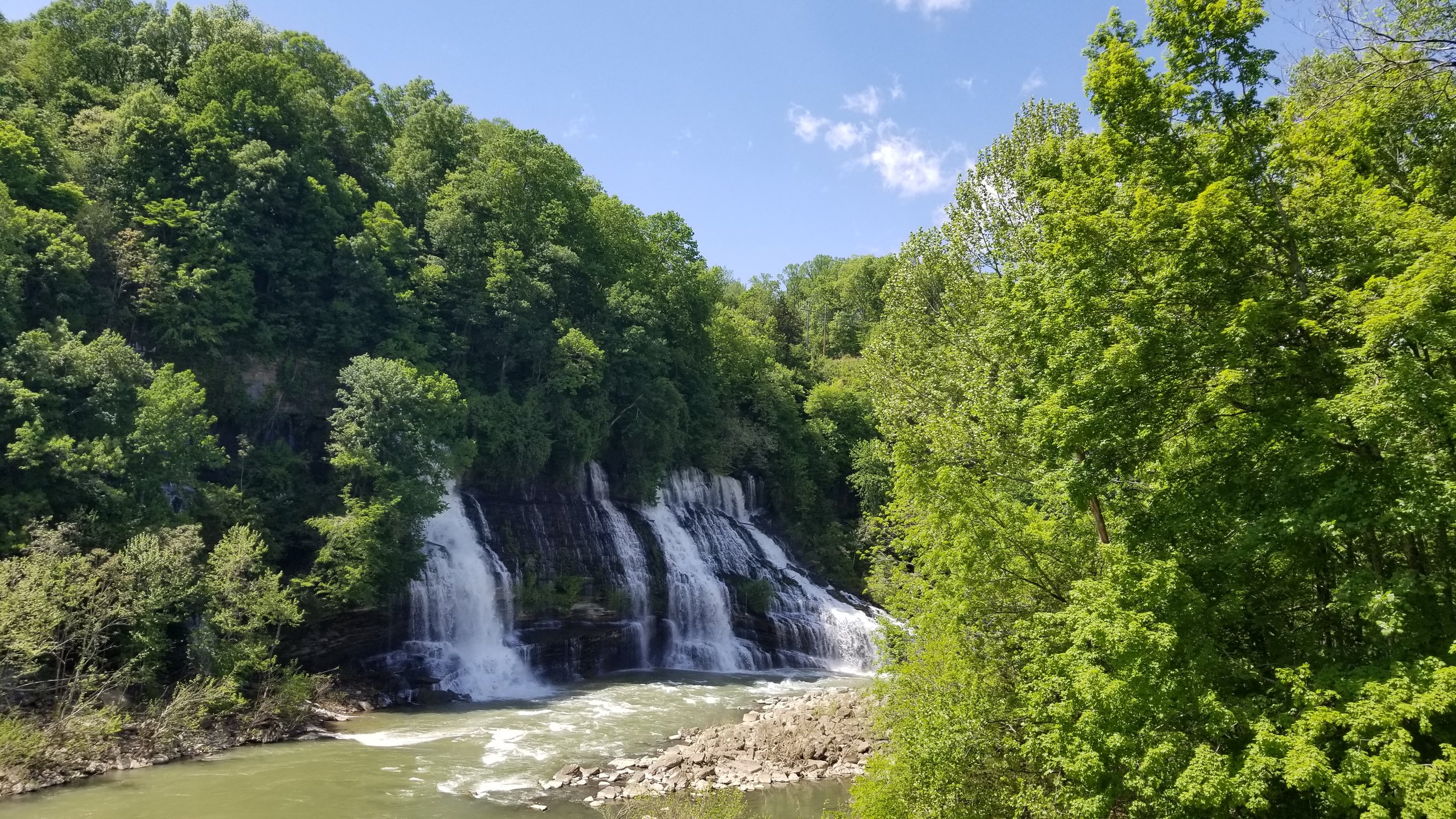 Twin Falls at Rock Island State Park are easily viewed either from the parking lot at the Powerhouse or via a trail that runs along the river below the parking lot.