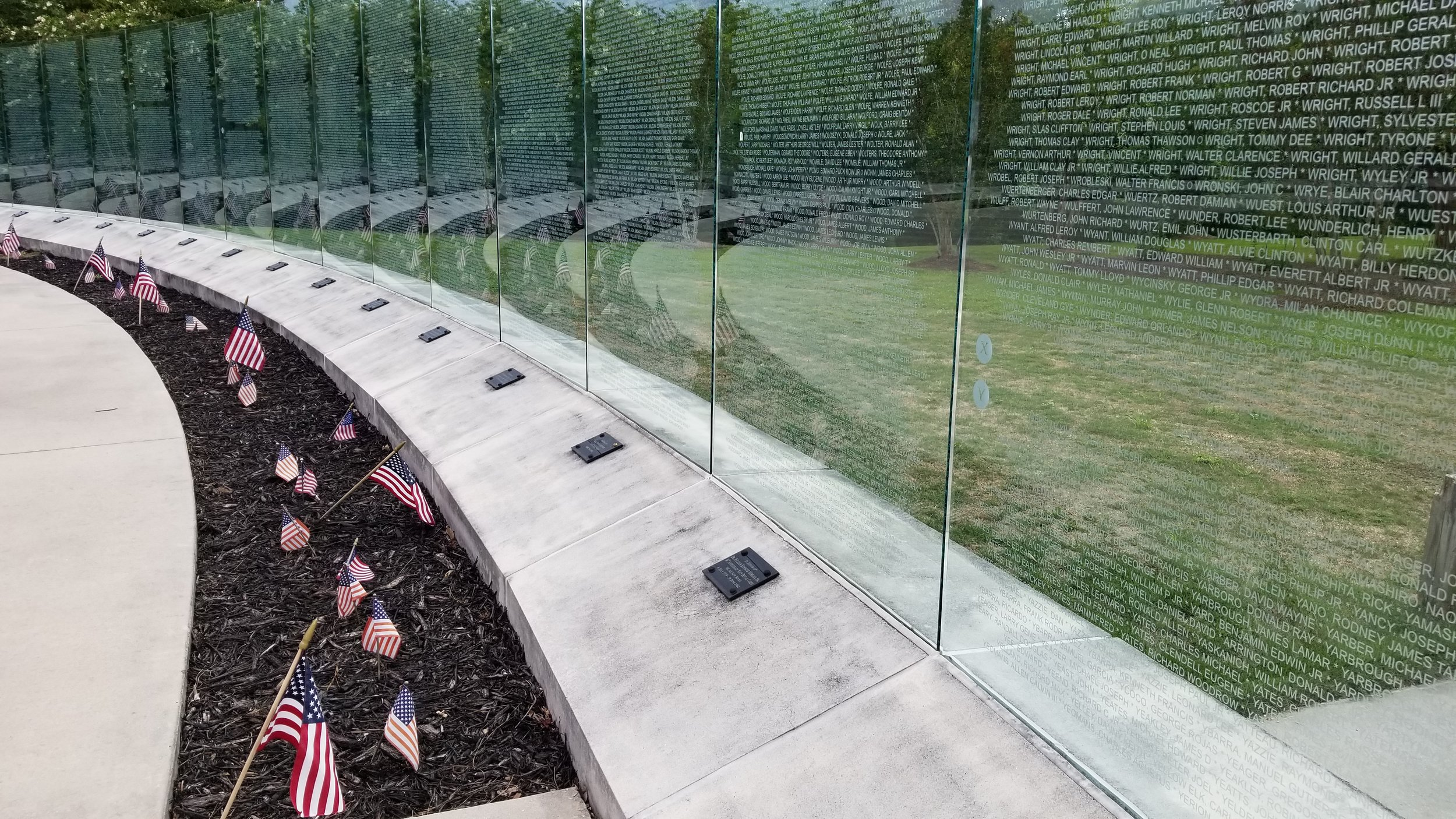 More than 58,000 names are etched into the glass at the Vietnam Veterans Memorial in Jacksonville, NC.