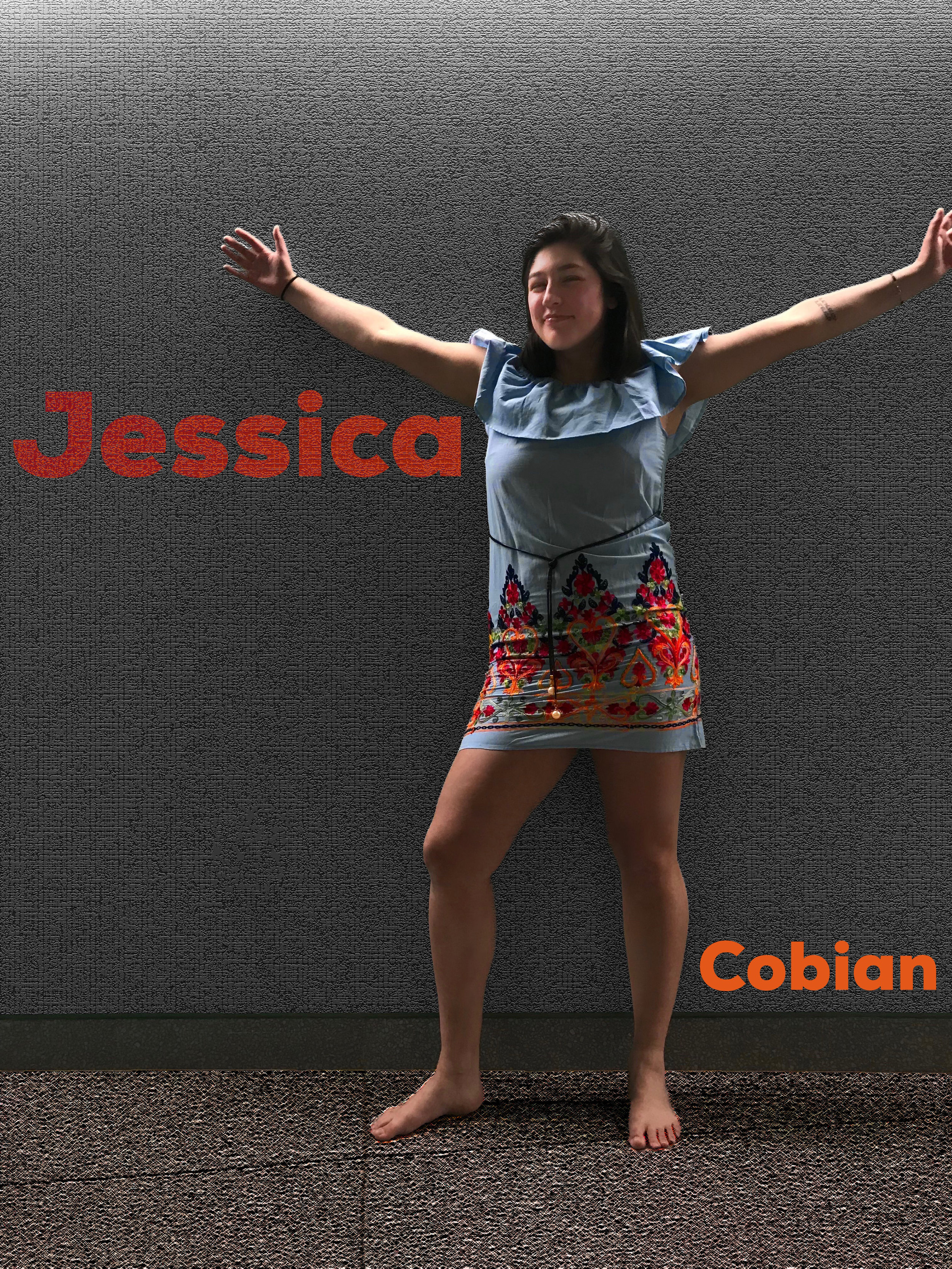 """Jessica Cobian- Modern Mexican Dress   While I was home, I saw the dress in my sister's closet, and I explained to her my dilemma of finding a cultural outfit. She thought this dress would be a good fit for the shoot. The colorful bottom reminds me of shirts and jeans I have seen on sale in stores in Mexico. The layered top resembles traditional Mexican style dresses but with a modern twist. The dress to me showed """"Mexican"""" as modern and stylish as opposed to un-developed. I chose to pose with open arms because Mexican families are welcoming and caring. I embrace my identity, and this dress reminded me of the things I love the most about my culture: color, warm smiles, and a sense of home."""