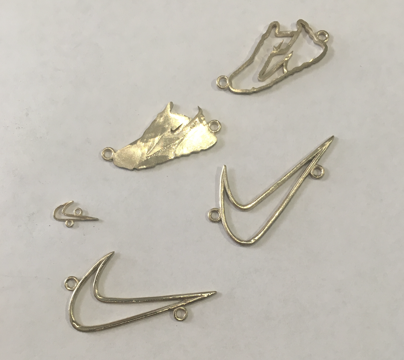 A few styles we casted in 14 kt gold, prior to polishing.