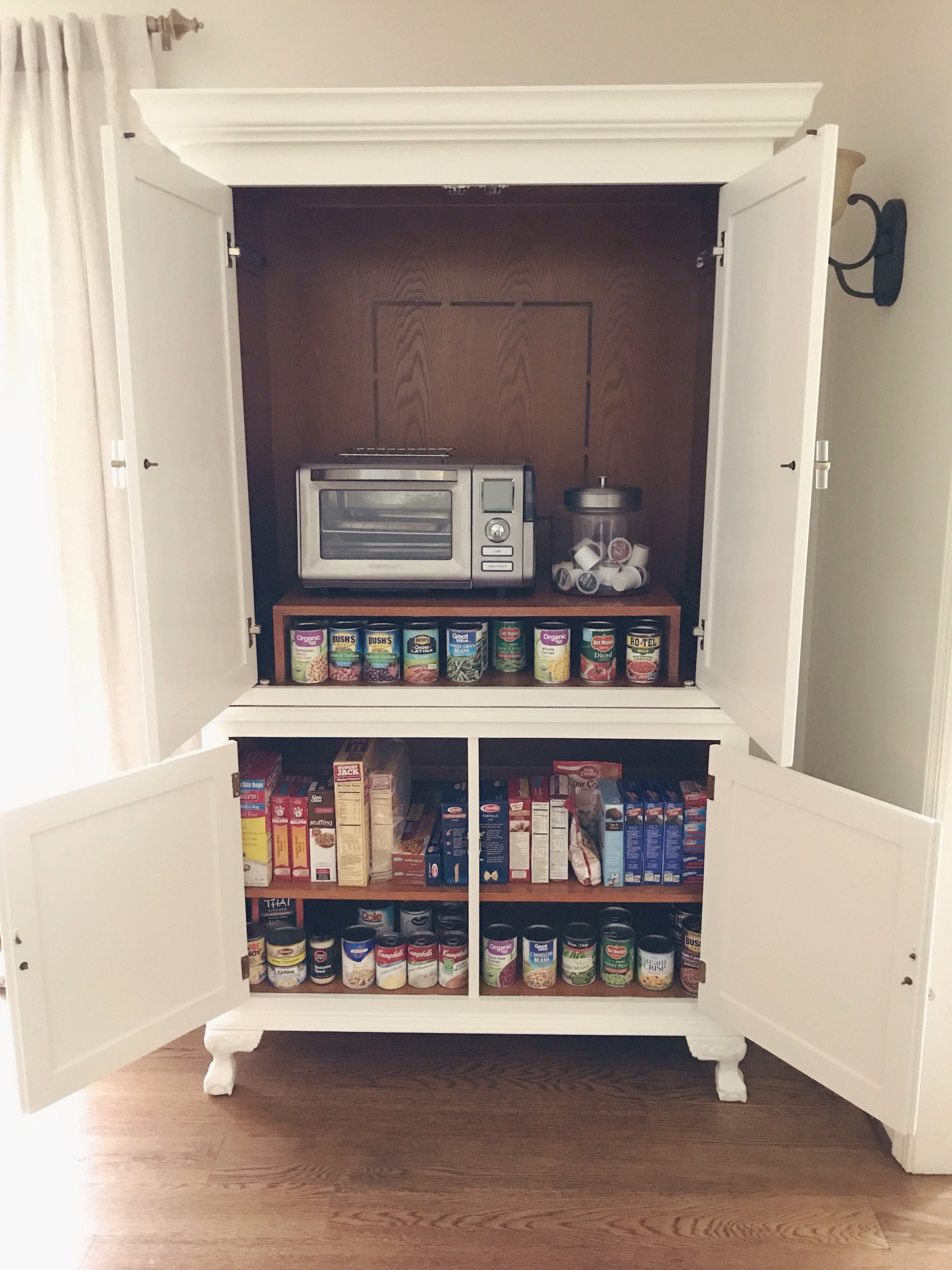 The armoire now holds all of our canned goods and boxed items, and hides our little oven. I have so much more cabinet space and can sort through things easily. Putting up groceries is no longer a pain, or as much of one anyway, haha!