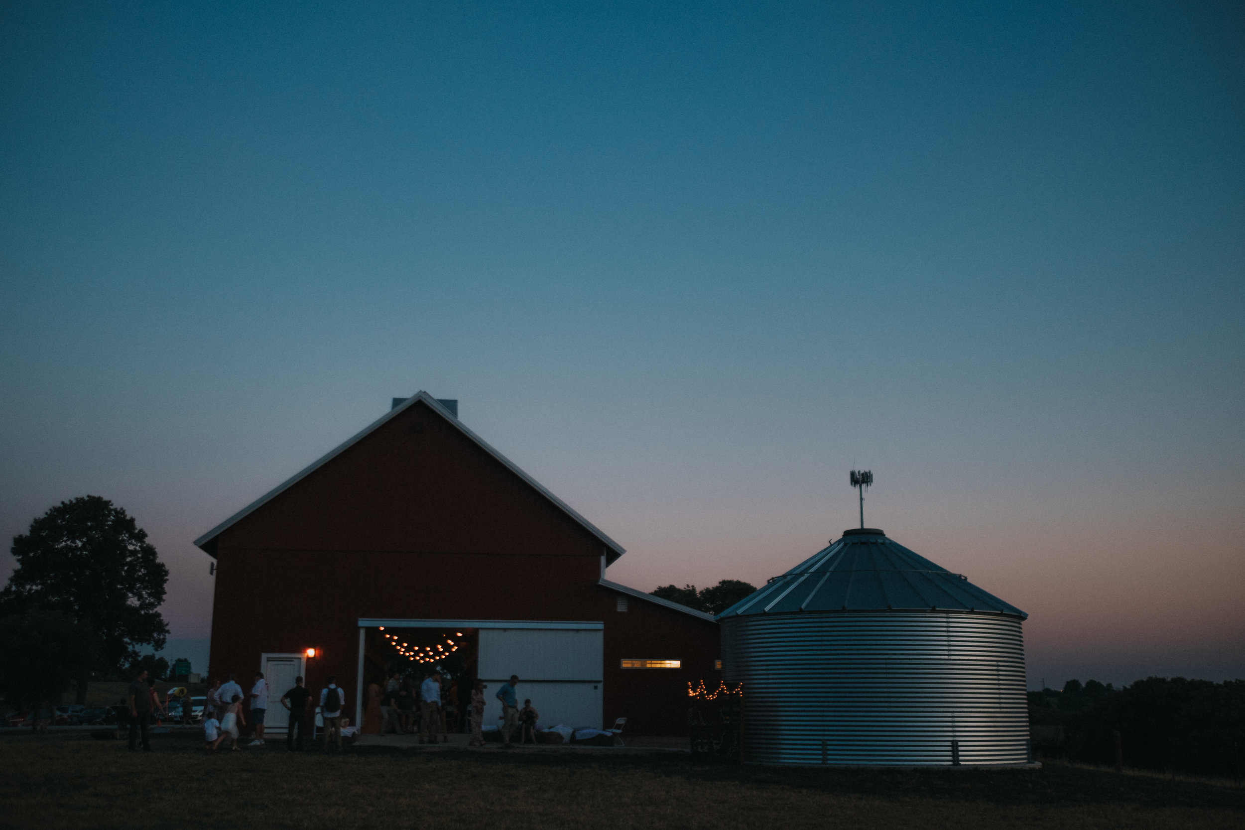 "Beth and Nate said ""I do"" - in an open, Kansas field behind a crimson red barn on a sunny day- a day full of teary eyes, heartfelt moments, and crazy joy."