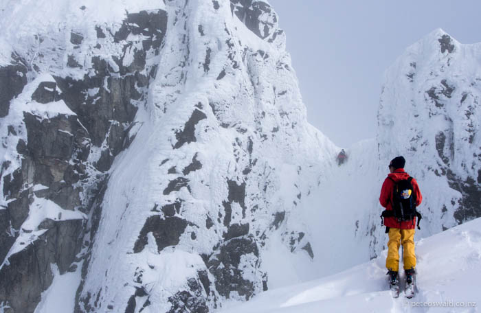 Fabi looks on as Neil scrambles up a chute to access their next line