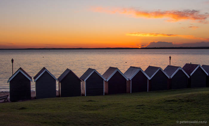Sunset at the beach huts near Gurnard Sailing Club, traditionally beach huts were used by woman before bathing in the sea