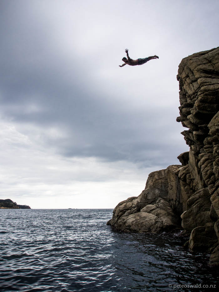 Will with a perfect old school swan dive off a cliff after he climbed up the face of it