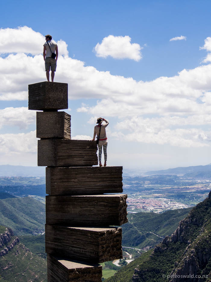 Will and Harry scale a sculpture at a Monastery at Montserrat, 1236m above the valley floor