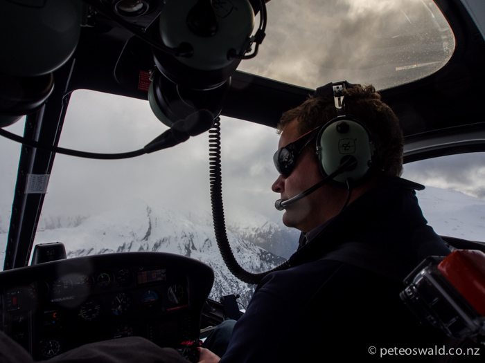 Toby, our pilot, manoeuvred us around cloud to safely put us on clean peaks