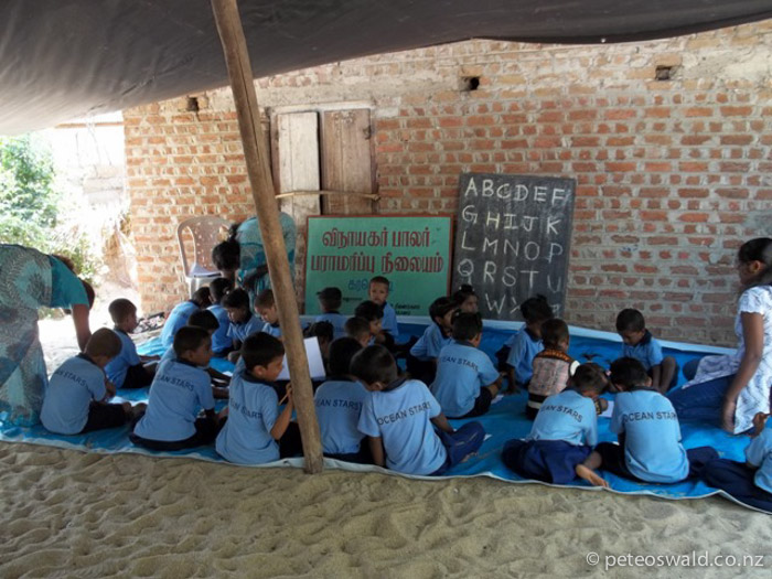 Students at the Karaveddy Preschool after a storm in 2011 ripped off the roof.