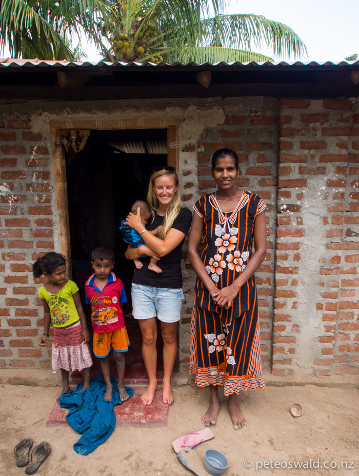 Soph with one of the Families that live near by, very proud people and happy with very few material things