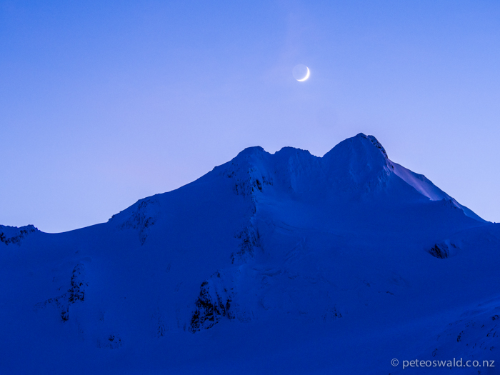 In the first light the moon sits above the Brewster peak