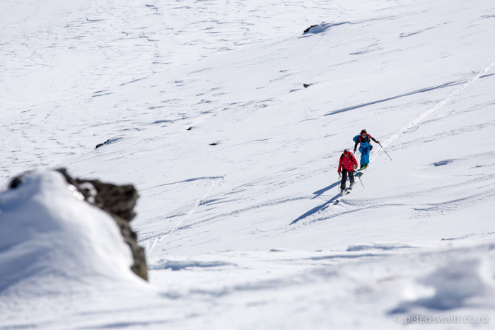 Touring in the  Cardrona backcountry for any sign of untracked dry snow. Photo: Dan Power