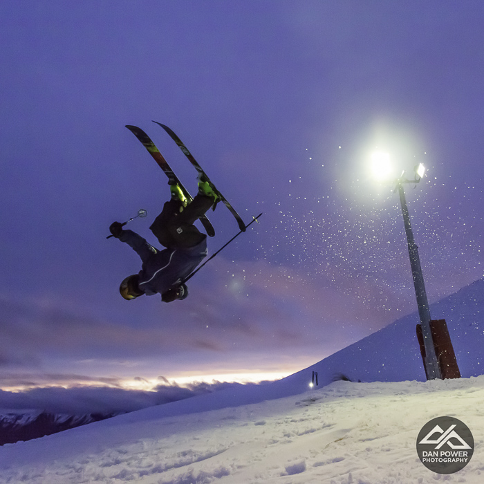 Getting upside down with sunset under lights at Coronet Peak. Photo: Dan Power