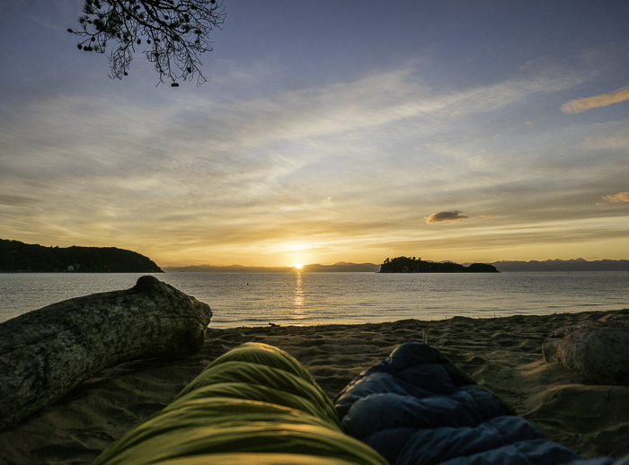 One of the best wake ups ever – a beautiful sunrise on a secluded beach in the Abel Tasman National Park, Nelson with my Sophie