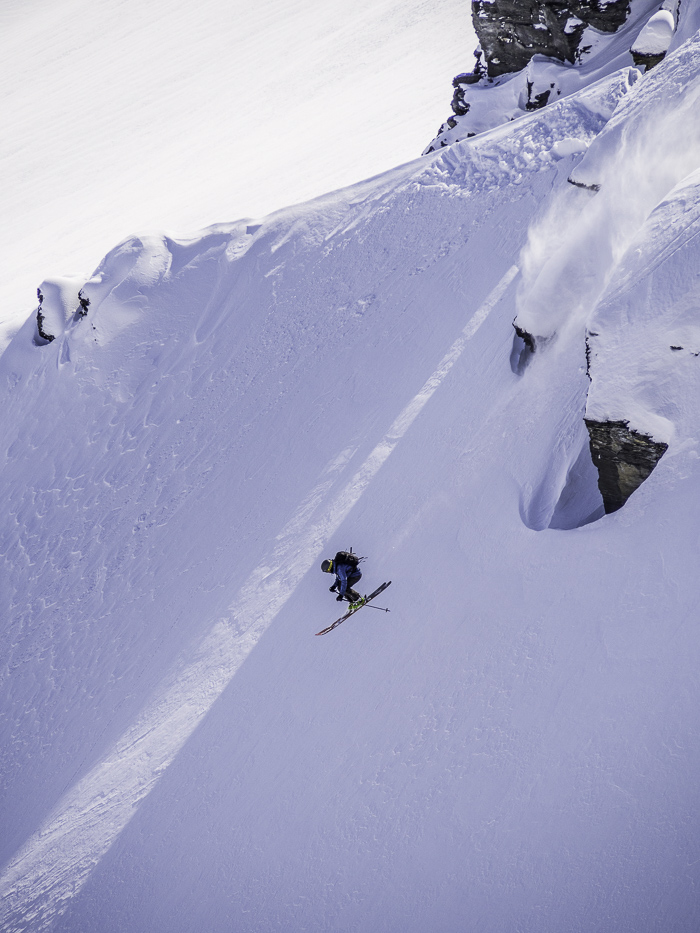 Taking a small cliff long out the bottom of some Treble Cone backcountry. Photo: Lukas Zögernitz