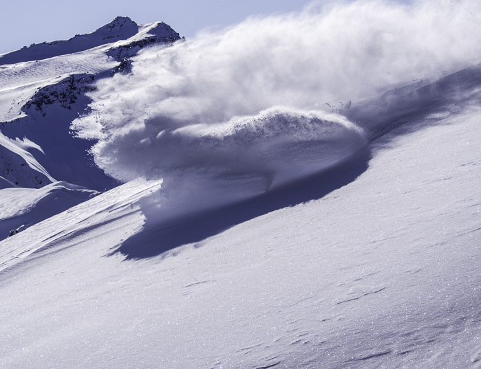 Powder cloud! Michael finding us the goods with Black Peak in the background. Photo: Lukas Zögernitz