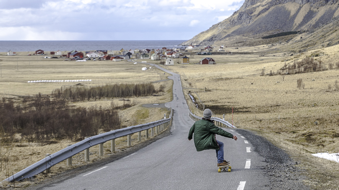 Bombing the hill to a tiny village on the coast. Photo: Sophie Stevens