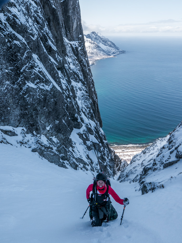 Tove finally gets to the top of a long skinny couloir that drains to the sea. Photo: Pete Oswald
