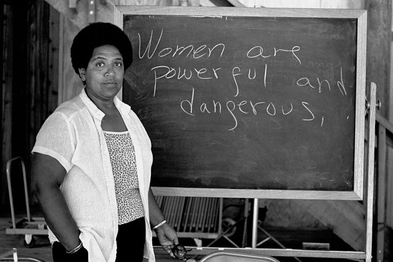"""ThoughtCo. """"Audre Lorde lecturing at the Atlantic Center for the Arts, New Smyrna Beach, Florida, 1983. Robert Alexander/Archive Photos/Getty Images"""