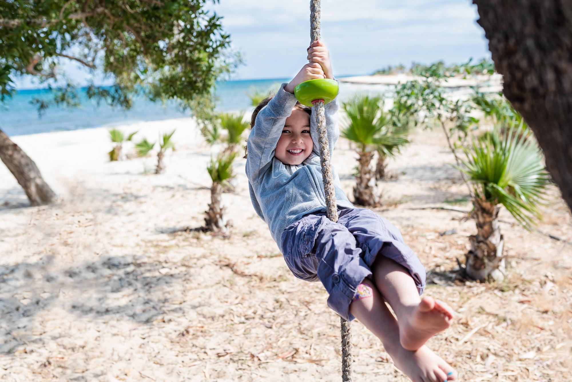 swinging in the air on the beach.jpg