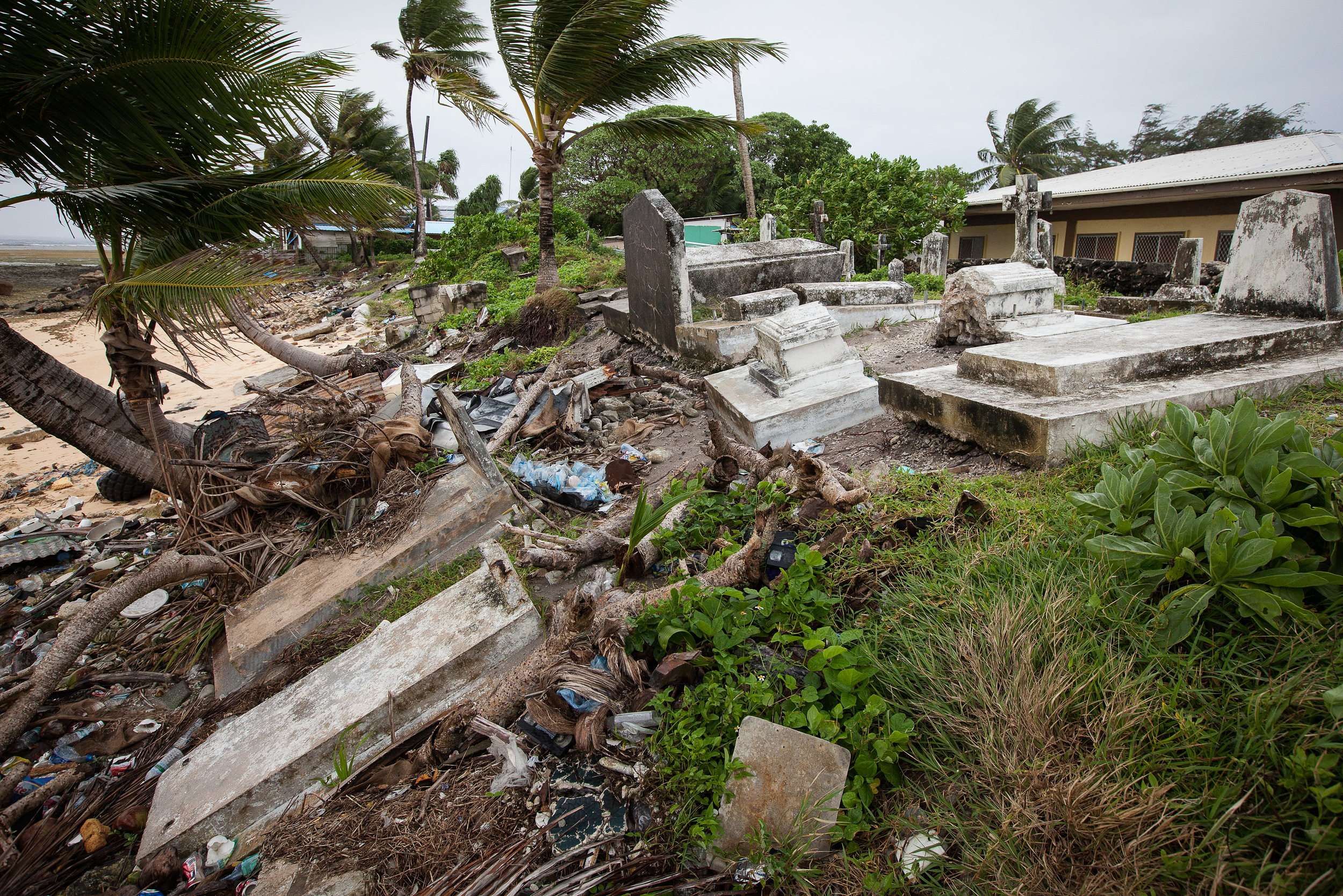 This graveyard in Uliga falls further down into the sea as each storm causes further erosion.