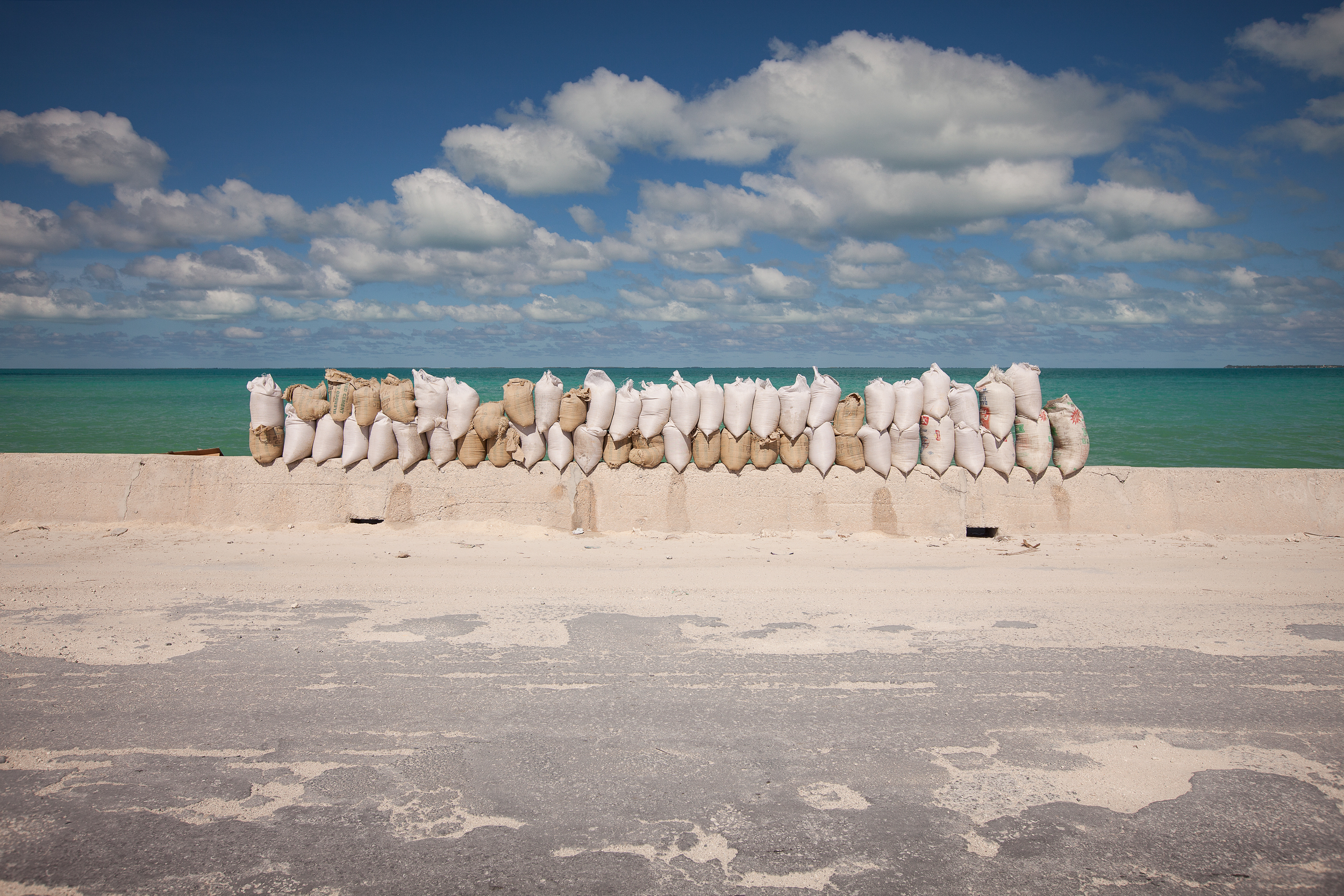 Sandbags pile up on the Betio causeway. There is only one road going from one end of Tarawa to the other, making it a crucial piece of infrastructure. The thin causeways linking bits of land together are particularly vulnerable to storm surges and waves, and require regular maintenance.