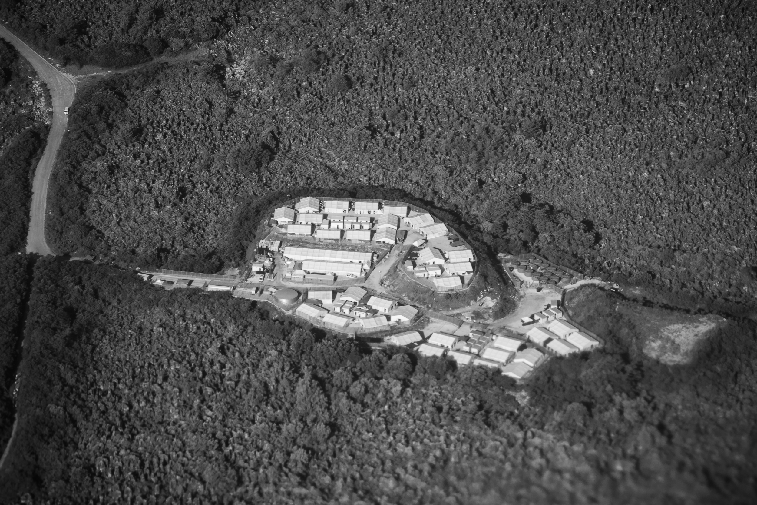 The detention centres are located in the middle of the island known to locals as 'Topside'. Topside is home to three Australian detention centres and the desolate remains of Nauru's once prosperous mining industry.