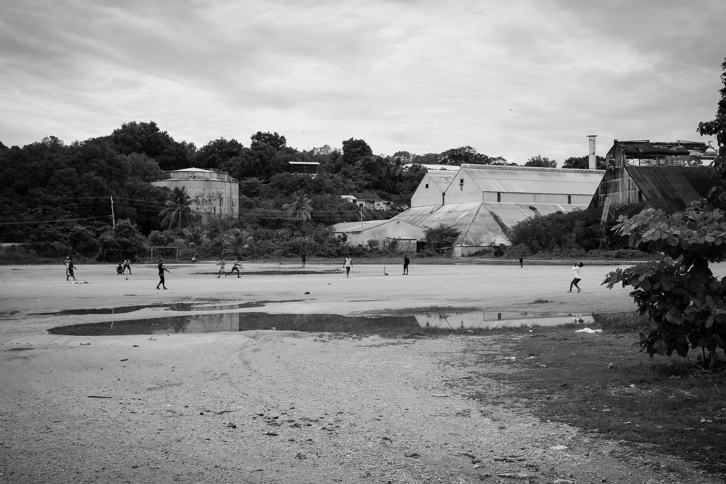 Tamil refugees play a game of cricket in Aiwo district. Refugees still held in detention can be taken out of the centres into the community, however are under constant watch from immigration officials.