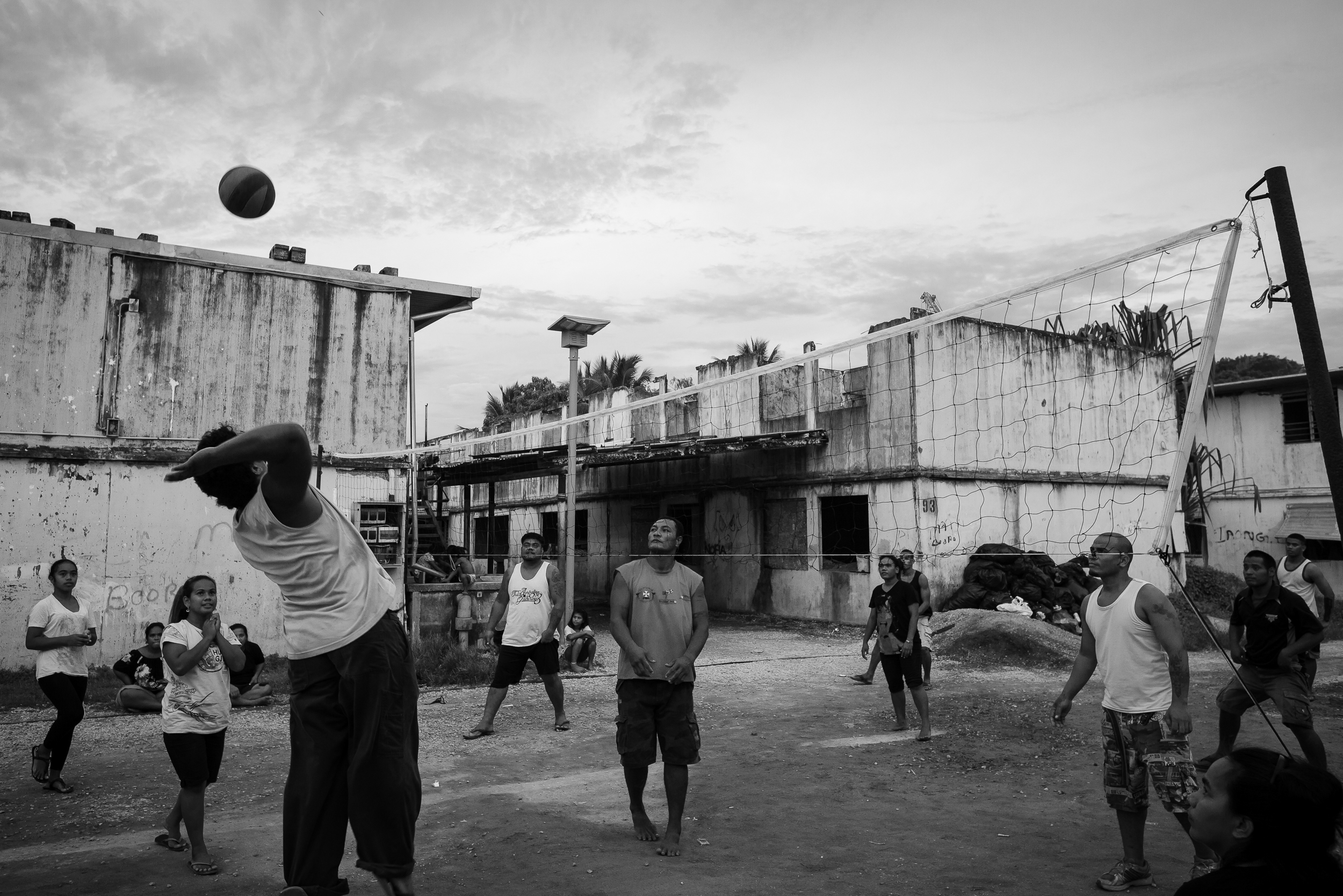 Locals play volleyball in Location Block. Many of the locals who live in this area actually own land elsewhere on Nauru that is used by the detention centres. They live here because it is cheap and the money they collect for the lease on their land elsewhere is enough for them to live on.