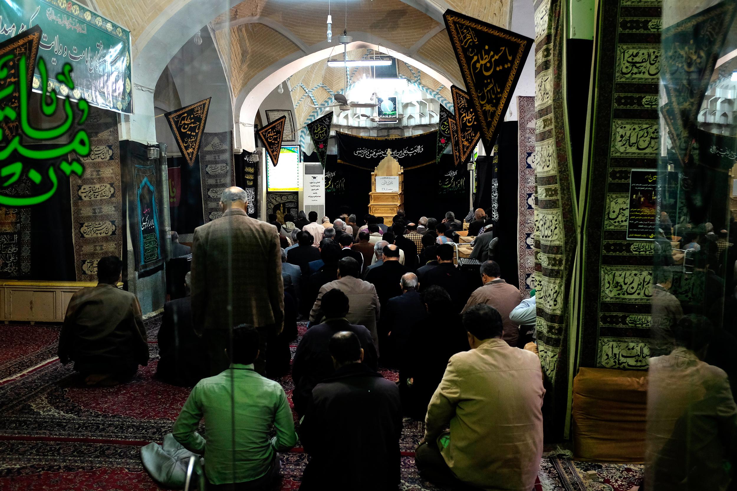 Men gather for prayer in Kashan.