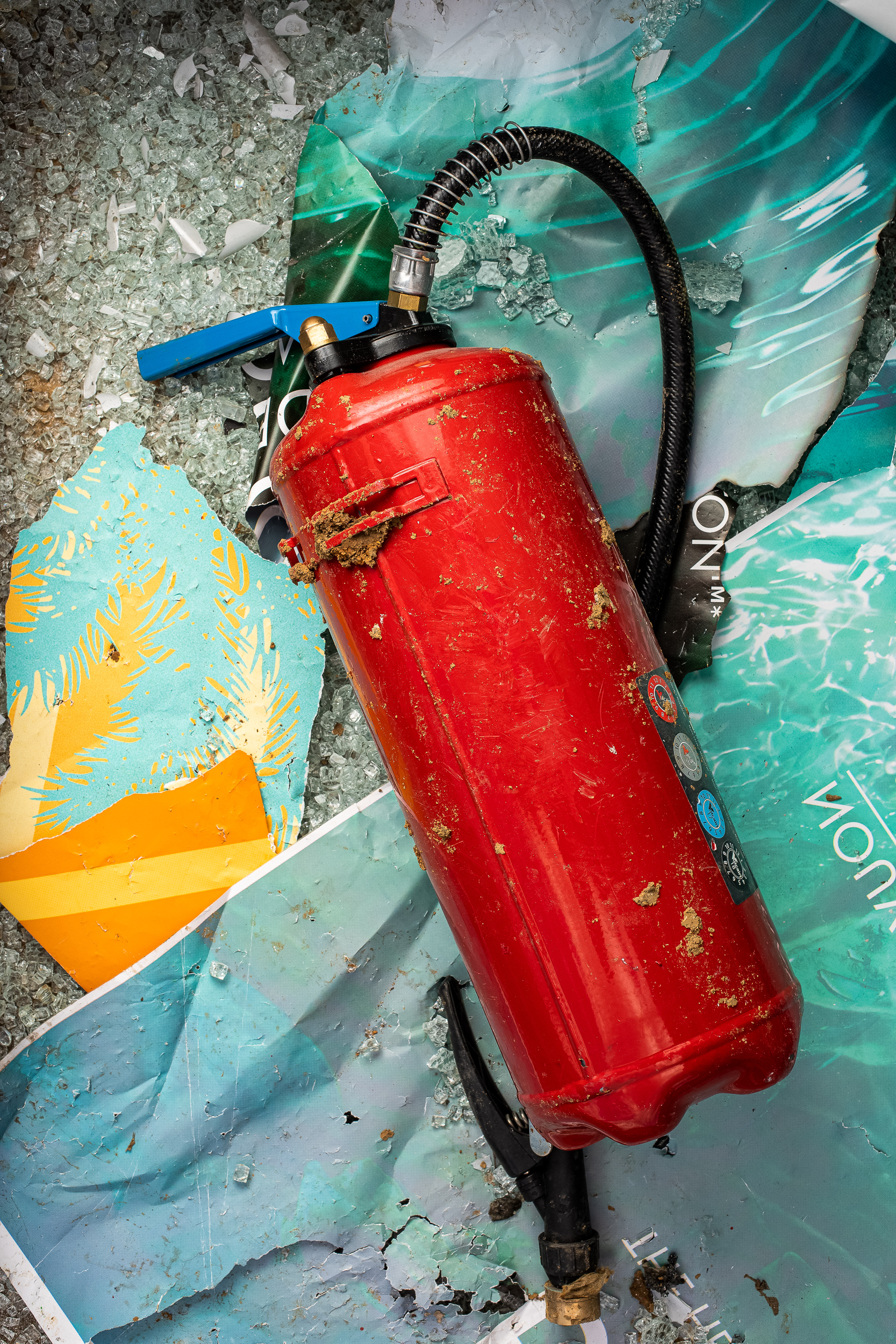 Fire extinguisher, torn posters & shattered glass, 2018